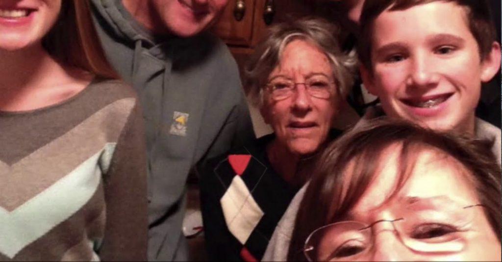 Charter Senior Living of Bay City Video Thumbnail Family Group Surrounded by senior living resident